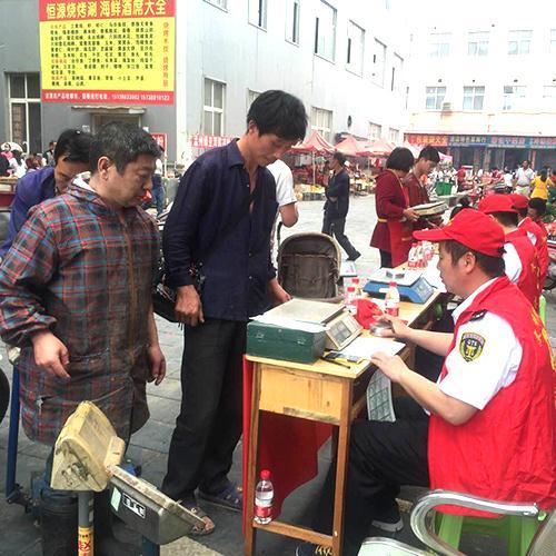 开展志愿者进市场检定